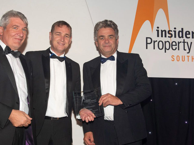 Simon Arnold accepting the award on the College's behalf