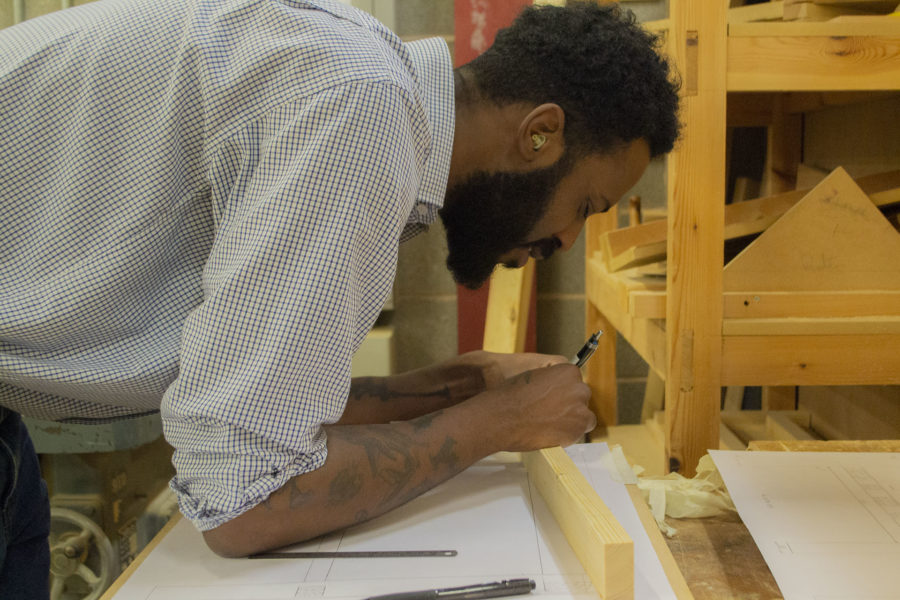 Student wood working in workshop at City of Bristol College