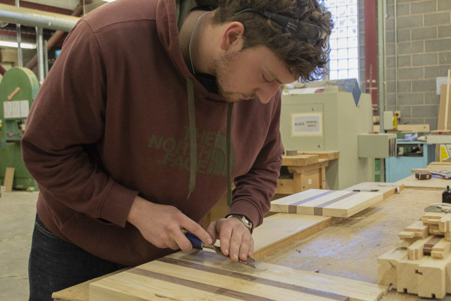 Student wood working in bench joinery workshop