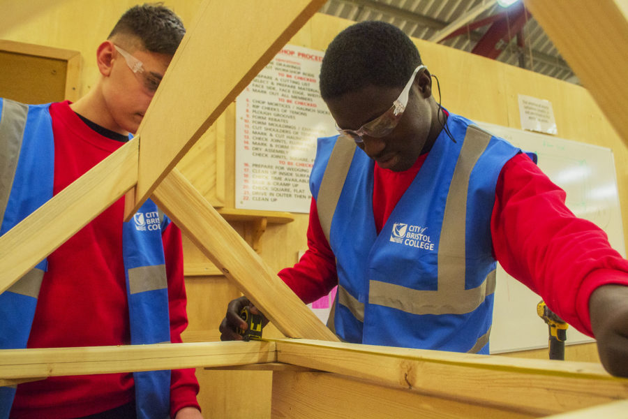 Carpentry. Bench joinery students measuring up a partially constructed project