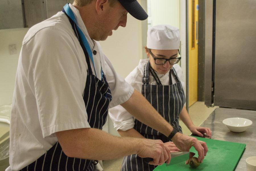 Tutor and student preparing food