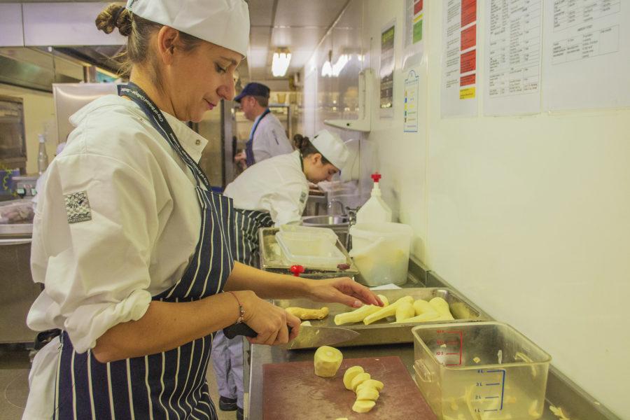 Student preparing food in kitchen