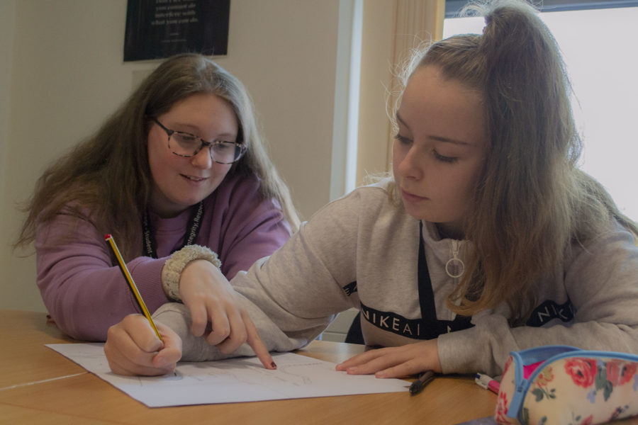 Students on a City of Bristol College Childcare course working together