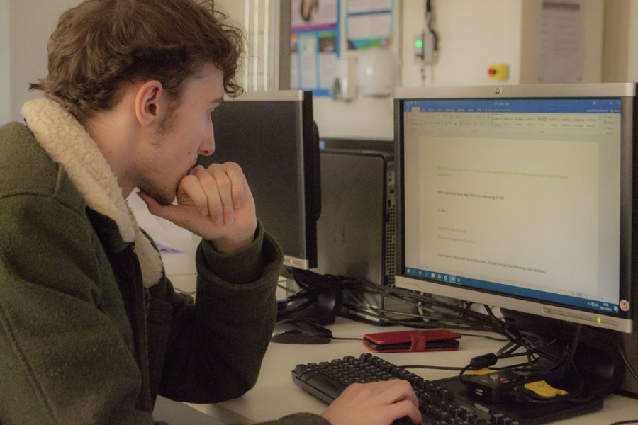 Student working at computer on word processing software