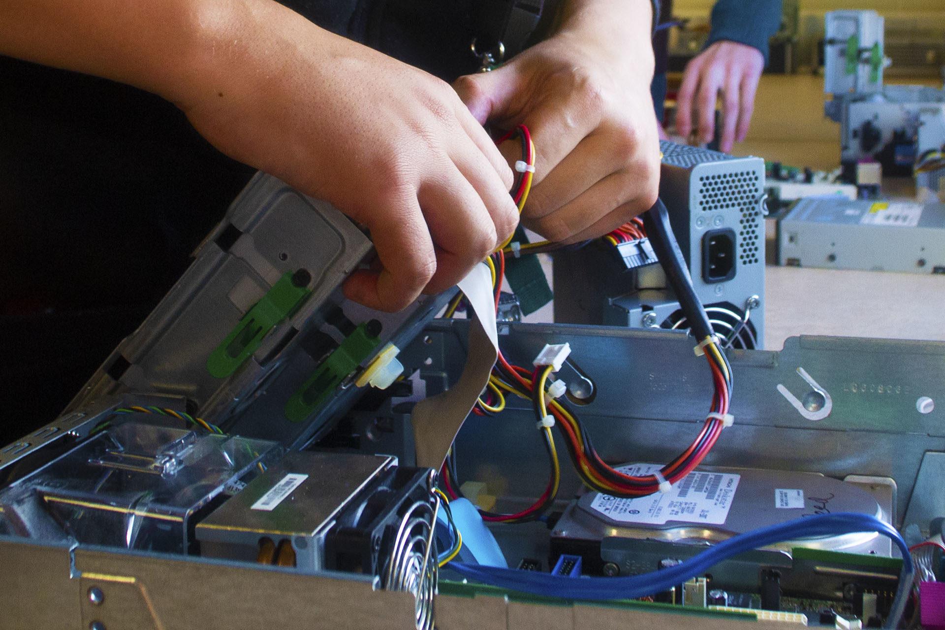 Computing. Students assembling computer hardware