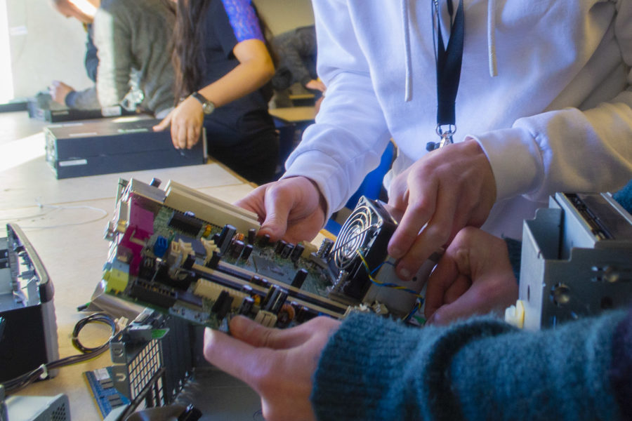 Computing. Students with motherboard