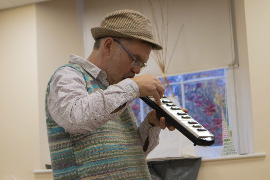 Creative Arts Therapy. Student playing melodica