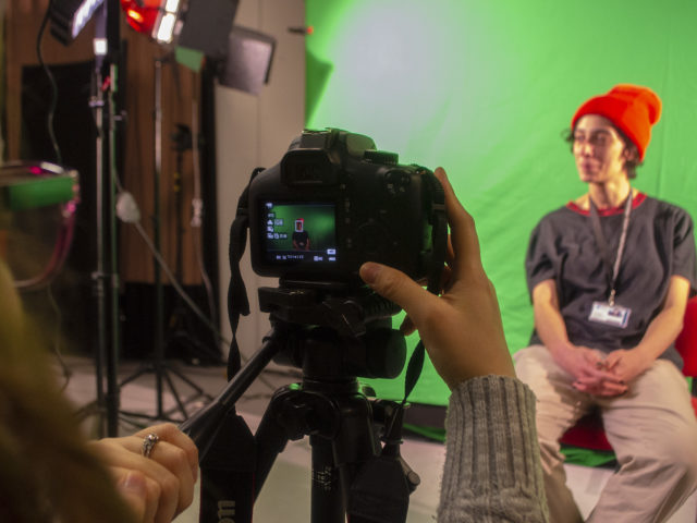 City of Bristol College Creative Media student filming on green screen