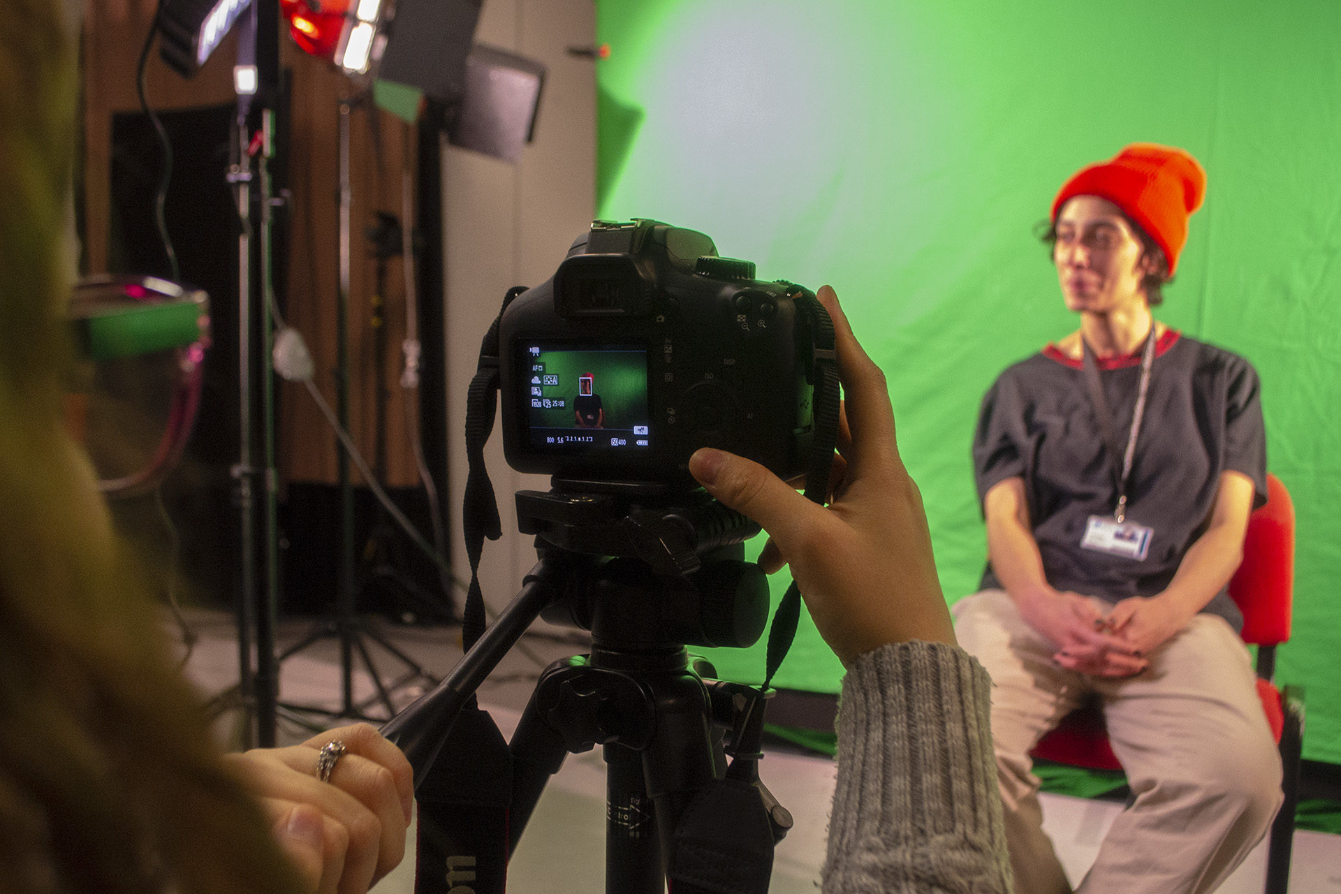 Creative Media. Student filming on green screen
