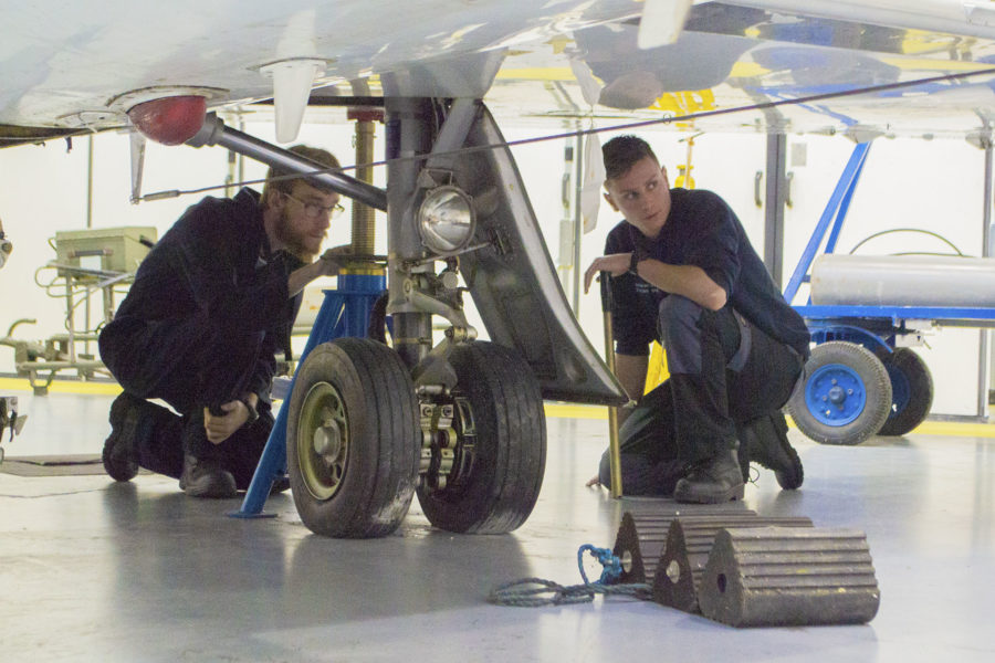 Aircraft students working on a plane