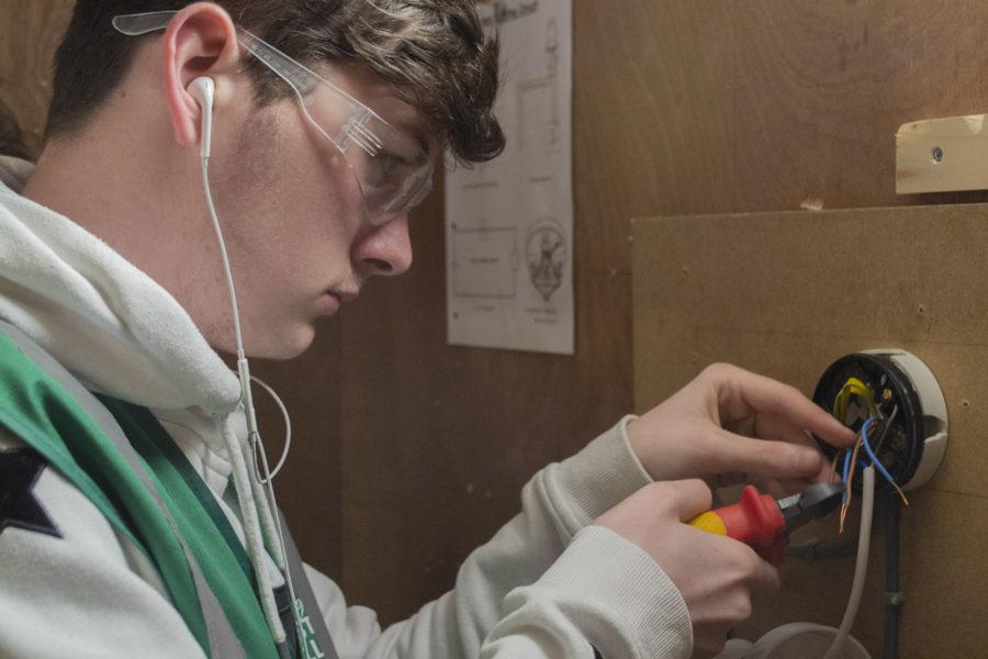 Student installing electrics