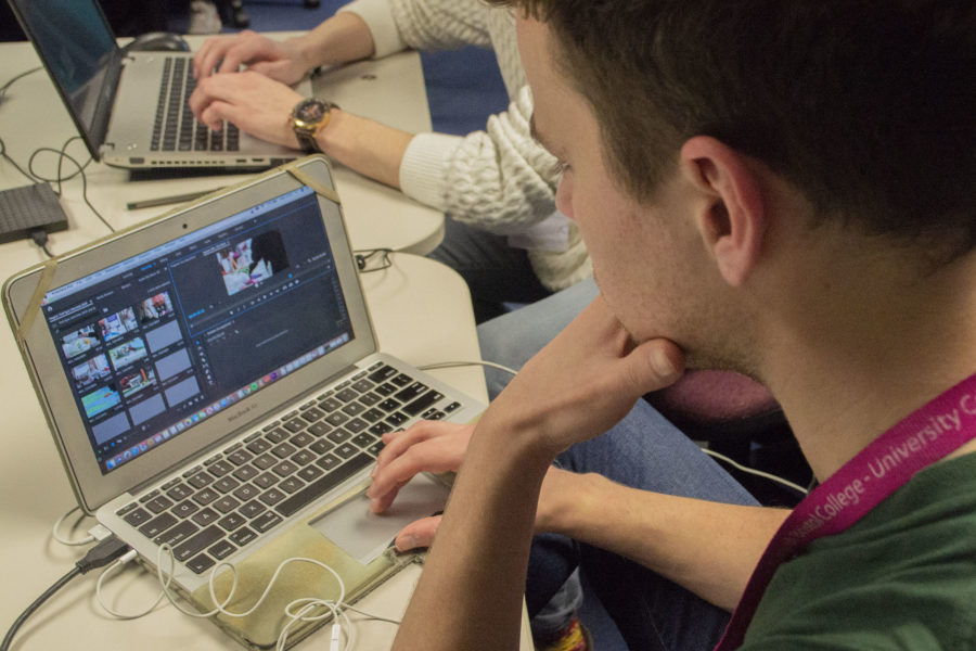Student editing film on computer for a creative course