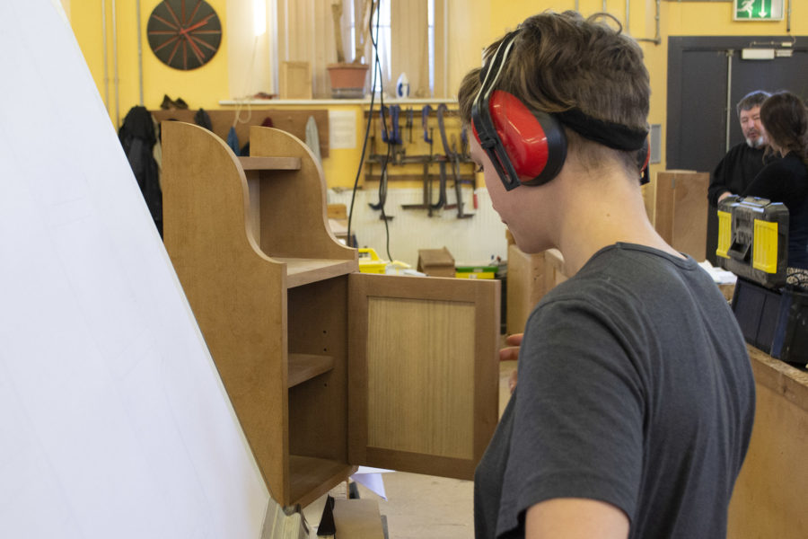 Student making cabinet