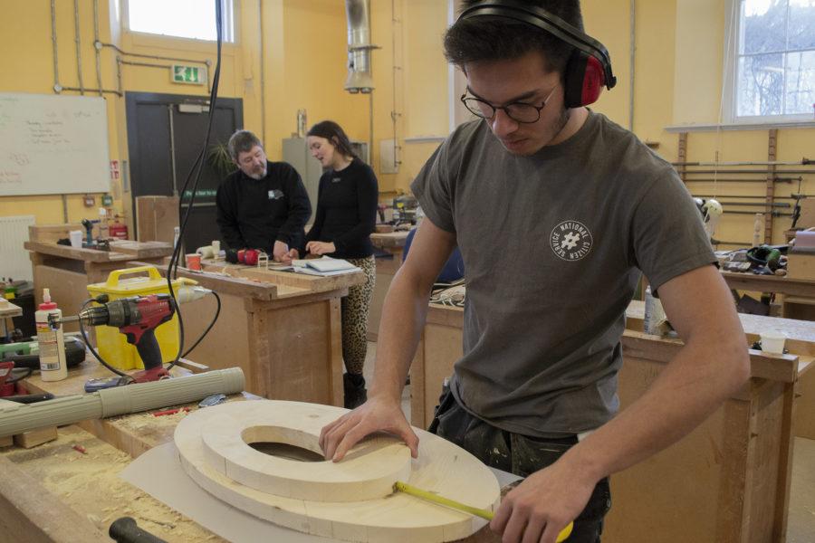 Student making furniture