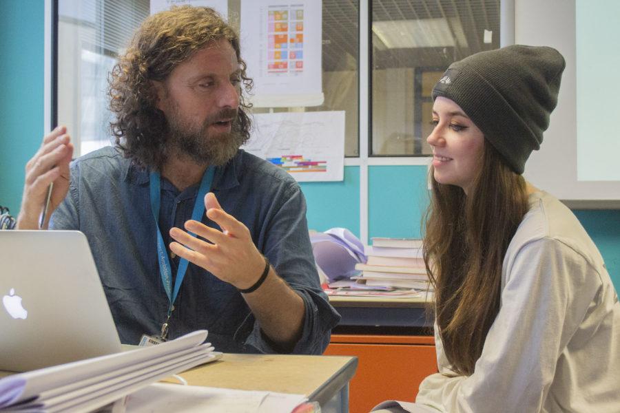 Graphic Design. Tutor & student discussing work
