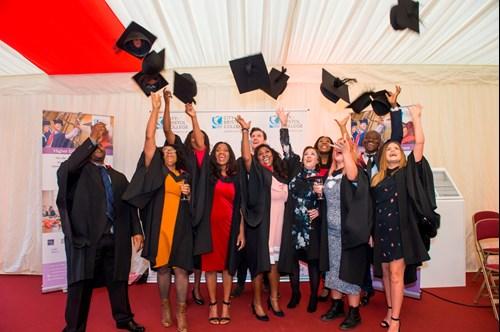Higher Education students celebrating at graduation