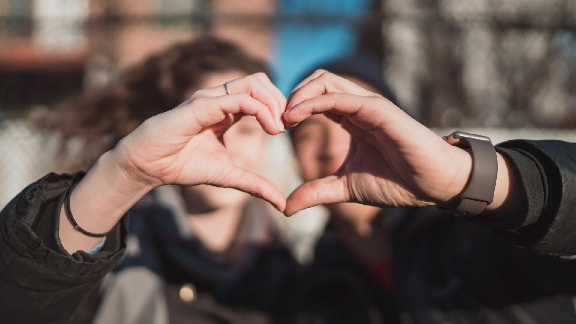 Support, student making heart sign with hands
