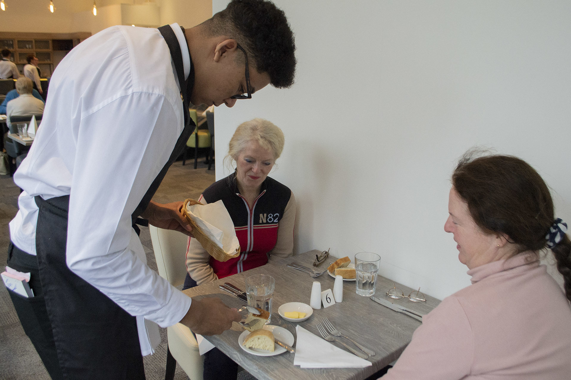 Hospitality - Student serving food