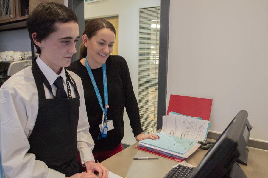 Hospitality - Student & tutor at reservation desk