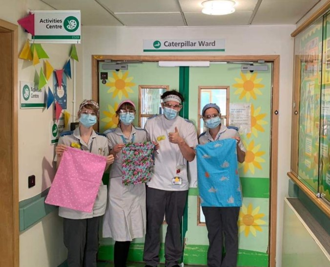 NHS staff with their new headbands and scrub washbags
