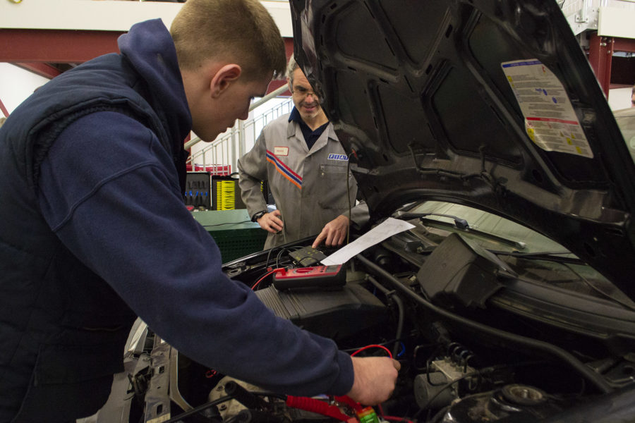 Light Vehicle. Students and tutor testing an engine