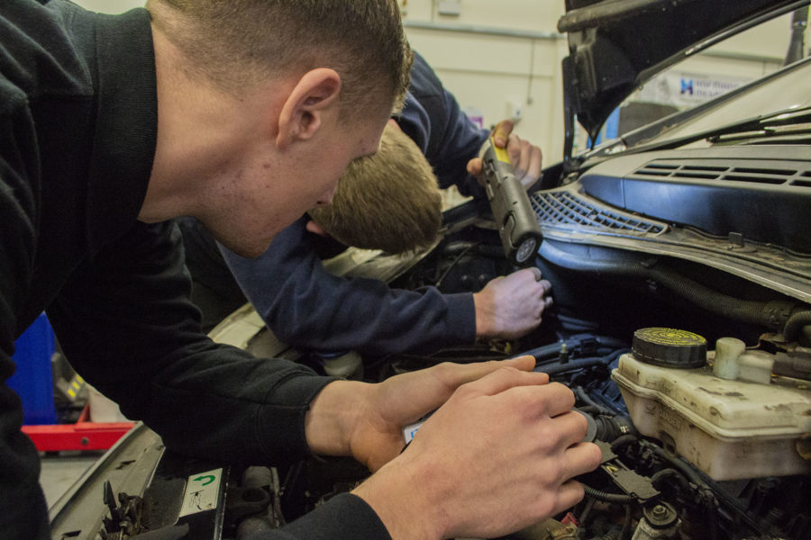 Light Vehicle. Students inspecting an engine