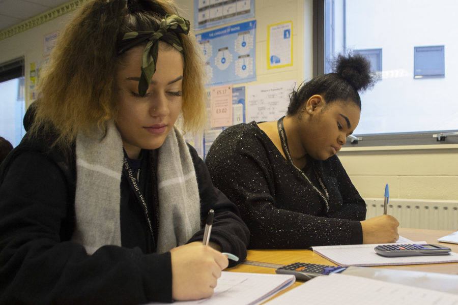 Maths students completing maths course work