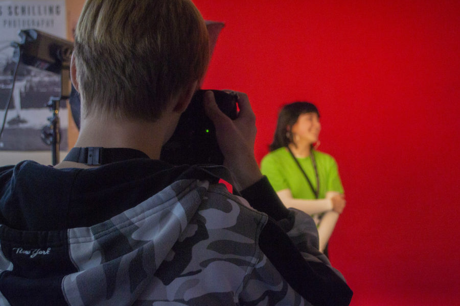 Photography. Student taking photos in studio