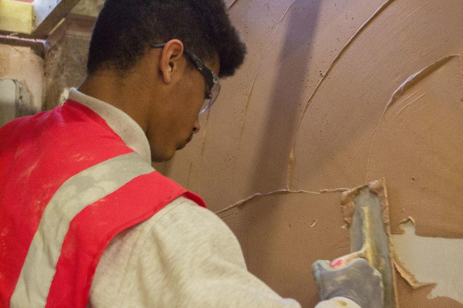 Student plastering