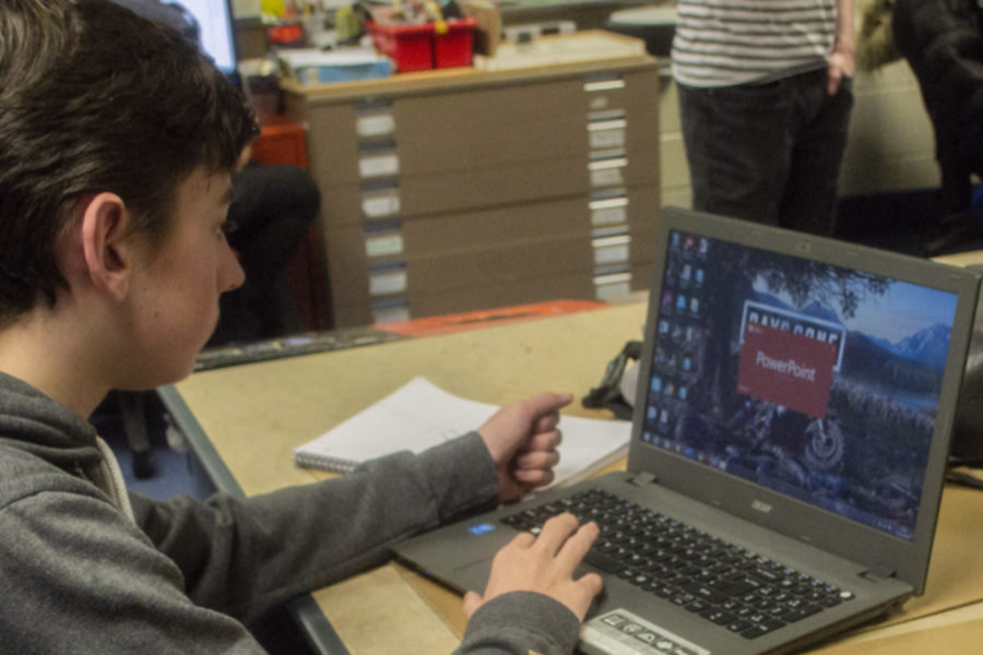 Student working on Powerpoint software