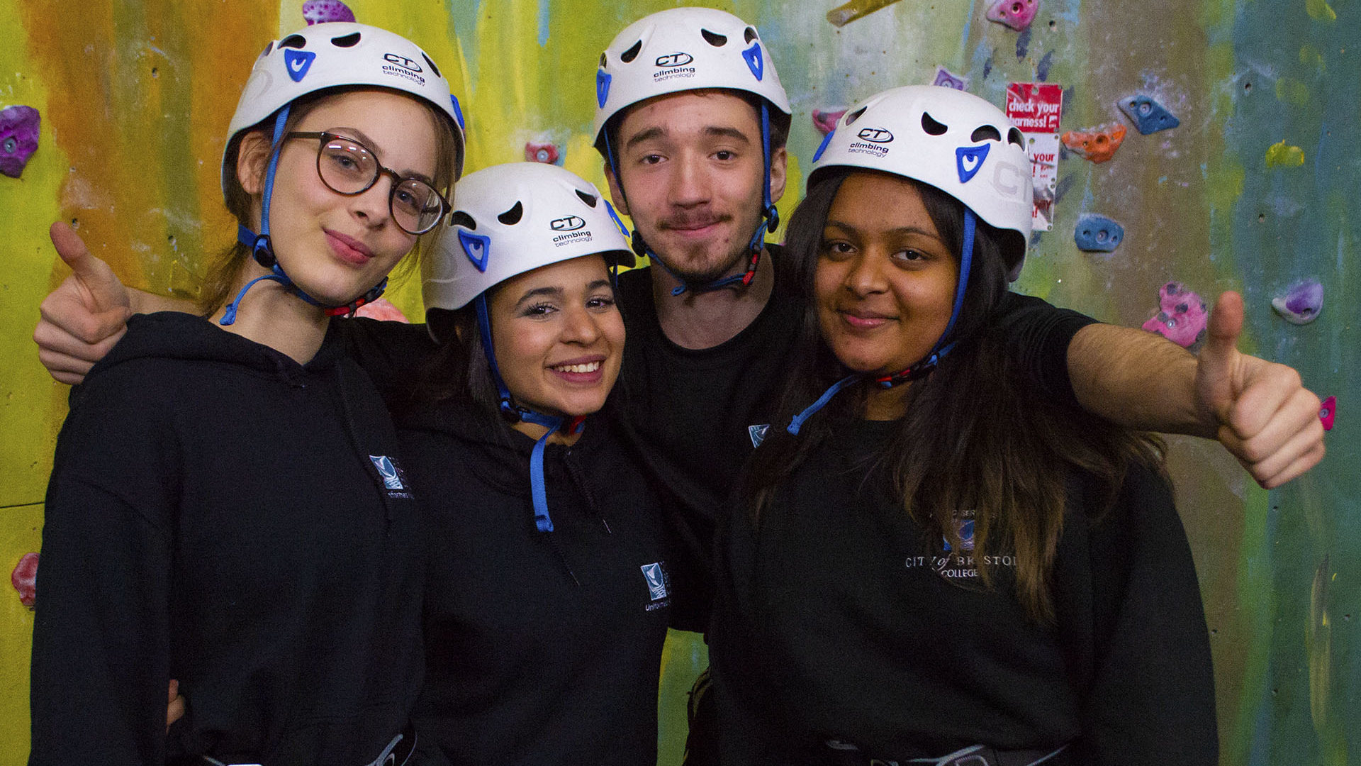 Public Services. Students at climbing wall, smiling