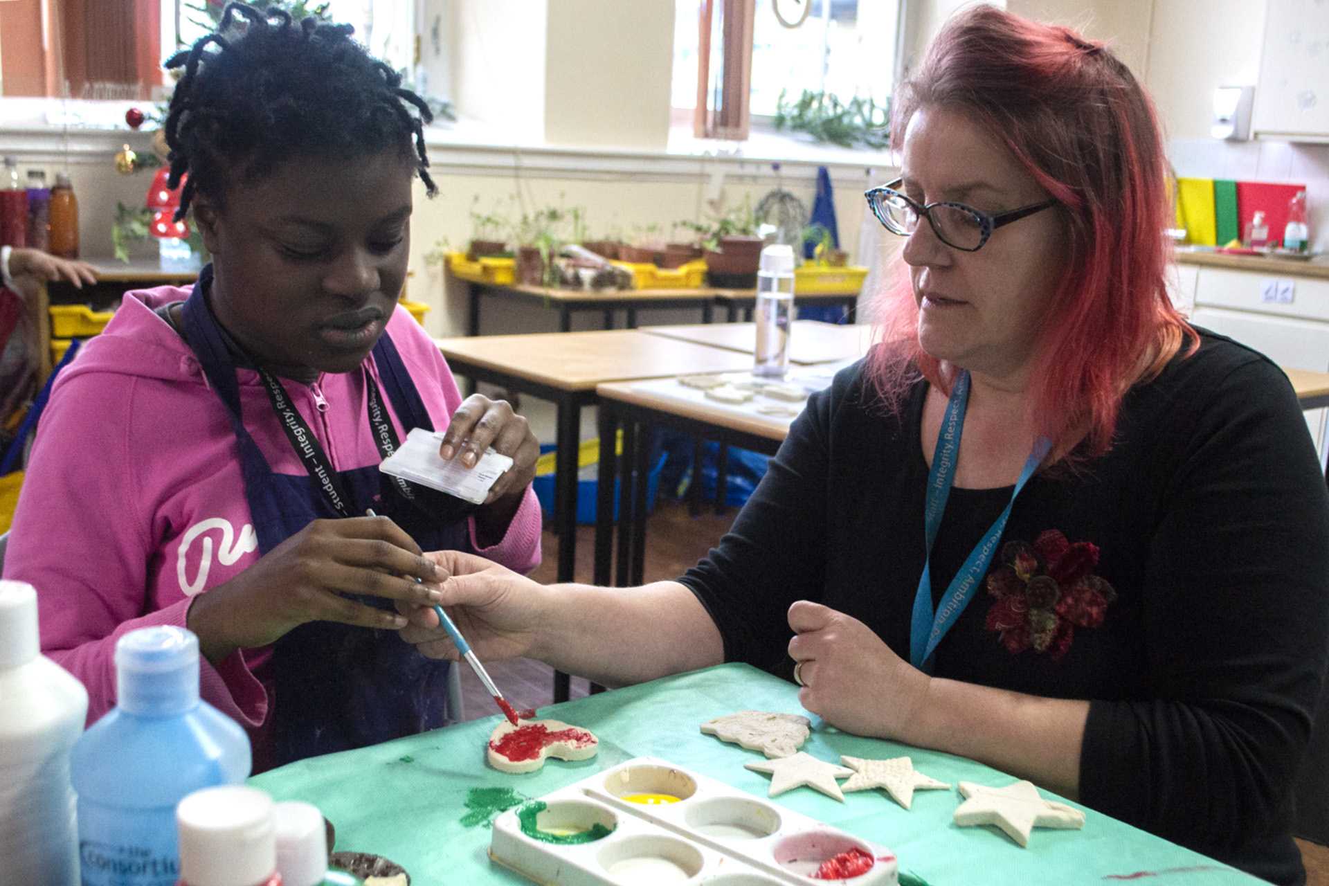 Tutor and Student using art and craft materials