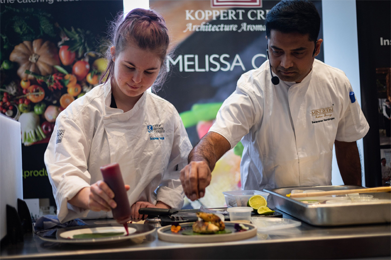 Saravanan Nambirajan working with a student to create the starter.