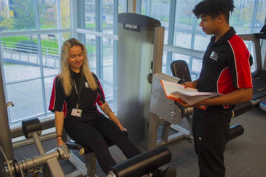 Sports Fitness. Students training on gym equipment