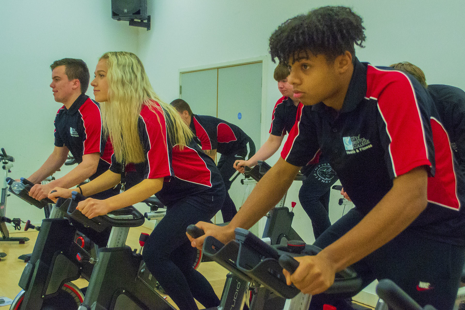 Sports Fitness. Students using training bikes in gym