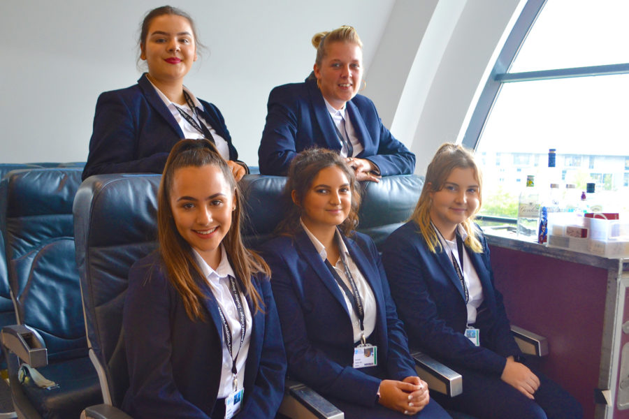 Travel & Tourism. Cabin Crew students & tutor, smiling to camera