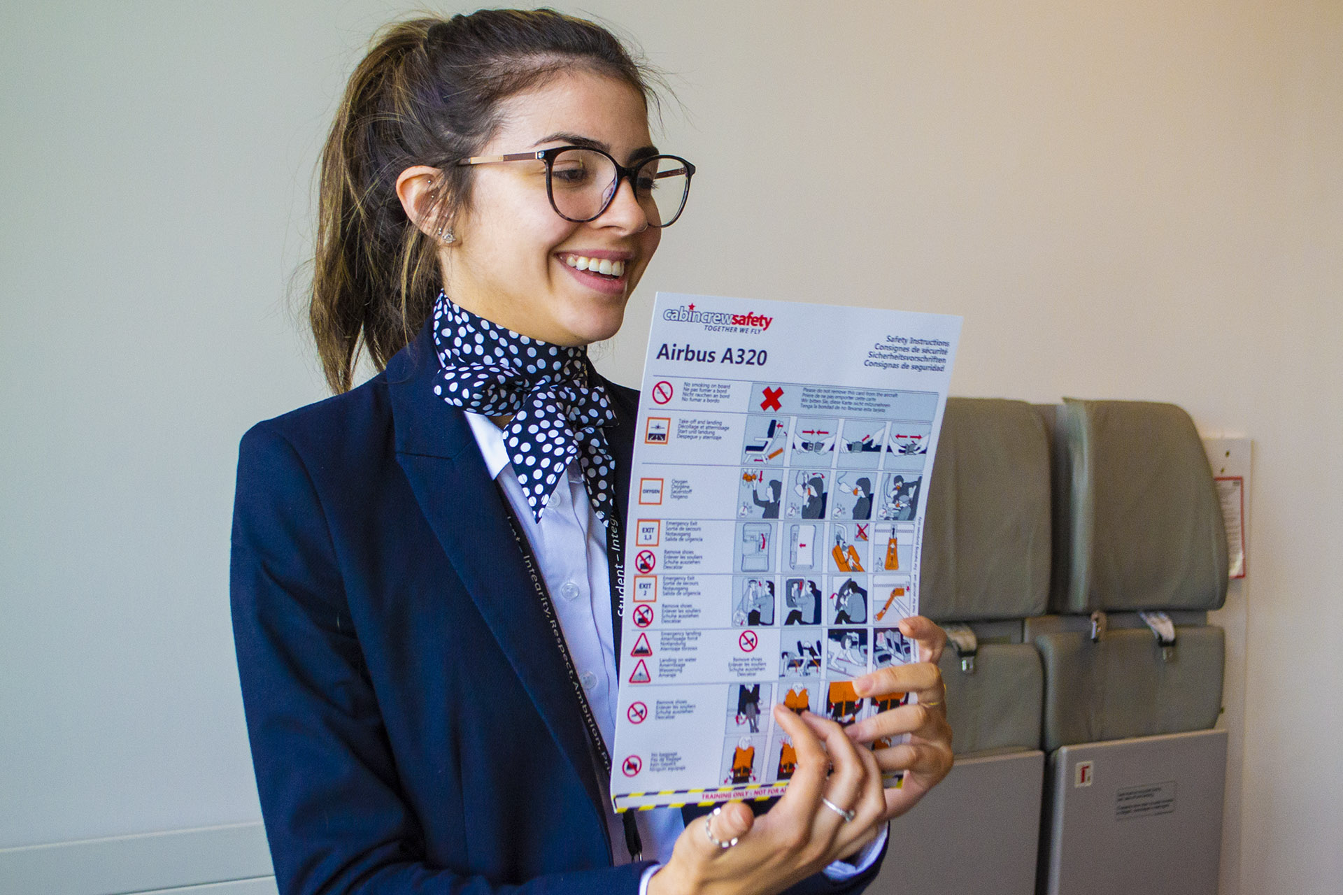 An Air Cabin Crew student practising taking passengers through a safety briefing.