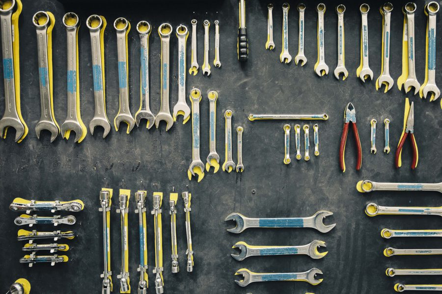 Wrenches and pliers hang up on a wall