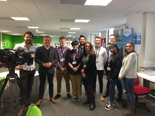 BBC Breakfast presenter, John Maguire, and students of City of Bristol College students standing next to camera equipment