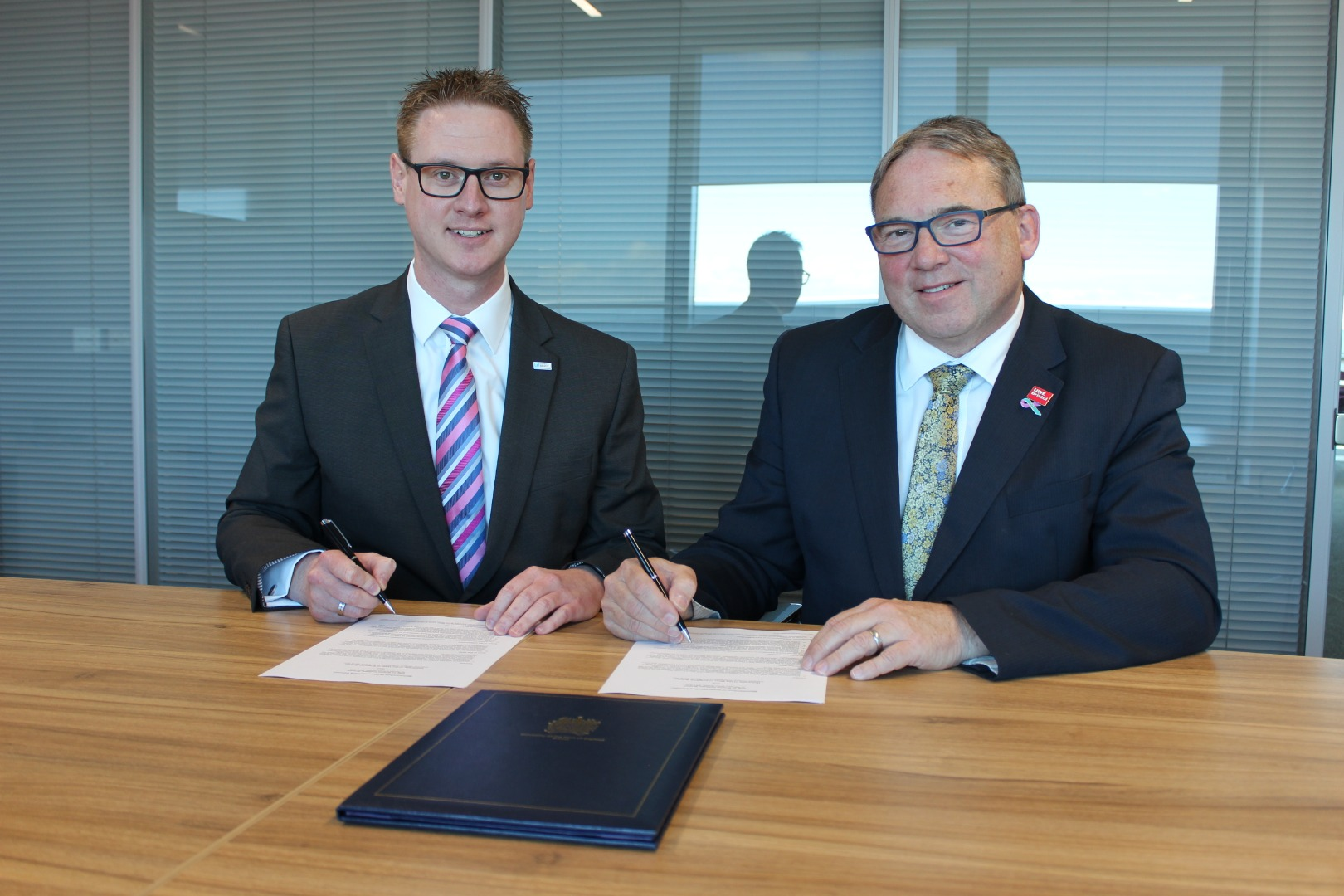 Professor Steve West, Vice-Chancellor of the University of the West of England, and Lee Probert, Principal and Chief Executive at City of Bristol College, sign documents