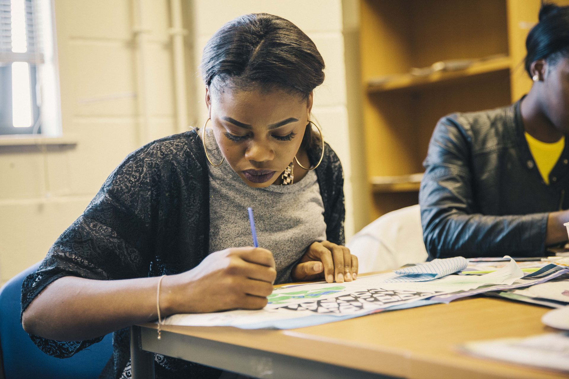 Childcare student, Adama Sesay studies at a desk