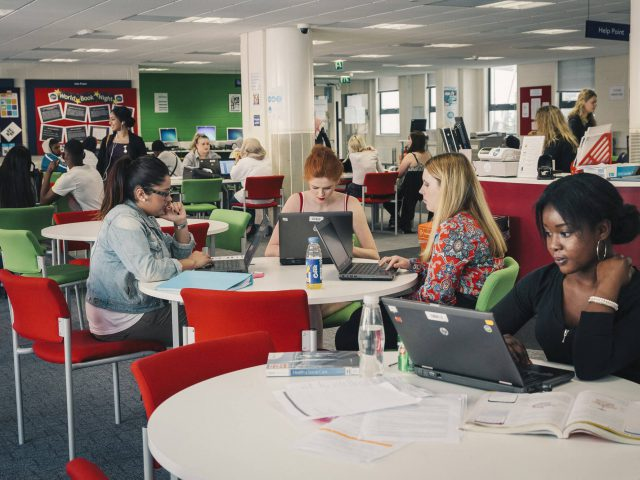 Students work in College Green Library