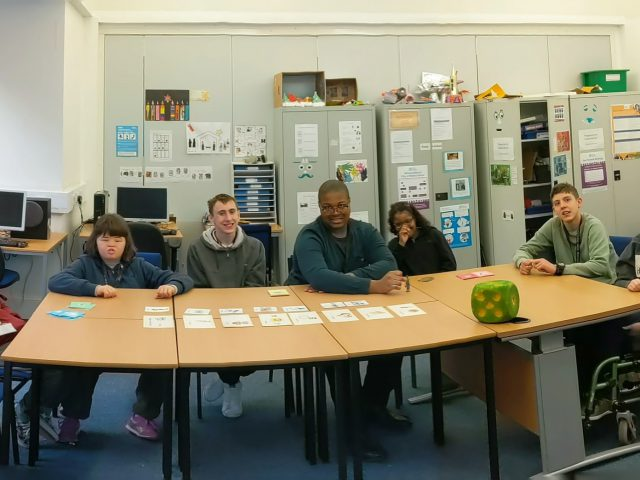 Creative-writing students sit around a table