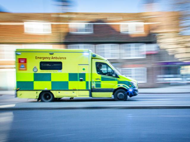 Ambulance driving past houses