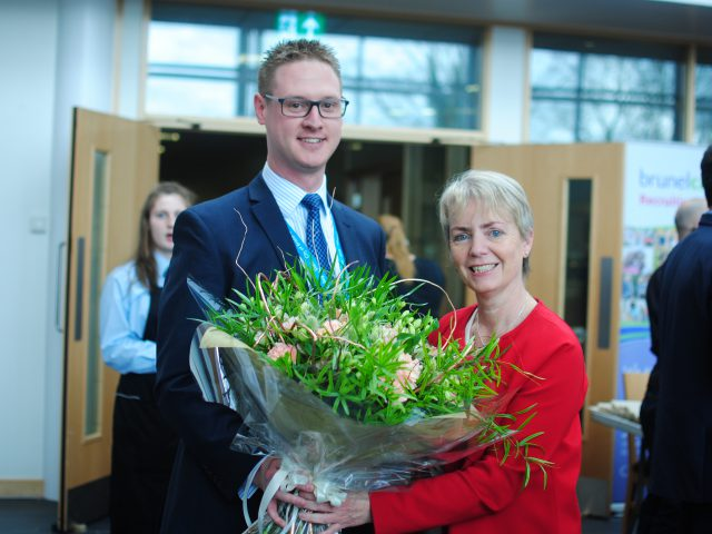 Bristol MP, Karin Smyth holding a bouquet of flowers with Lee Probert, Principal and Chief Executive