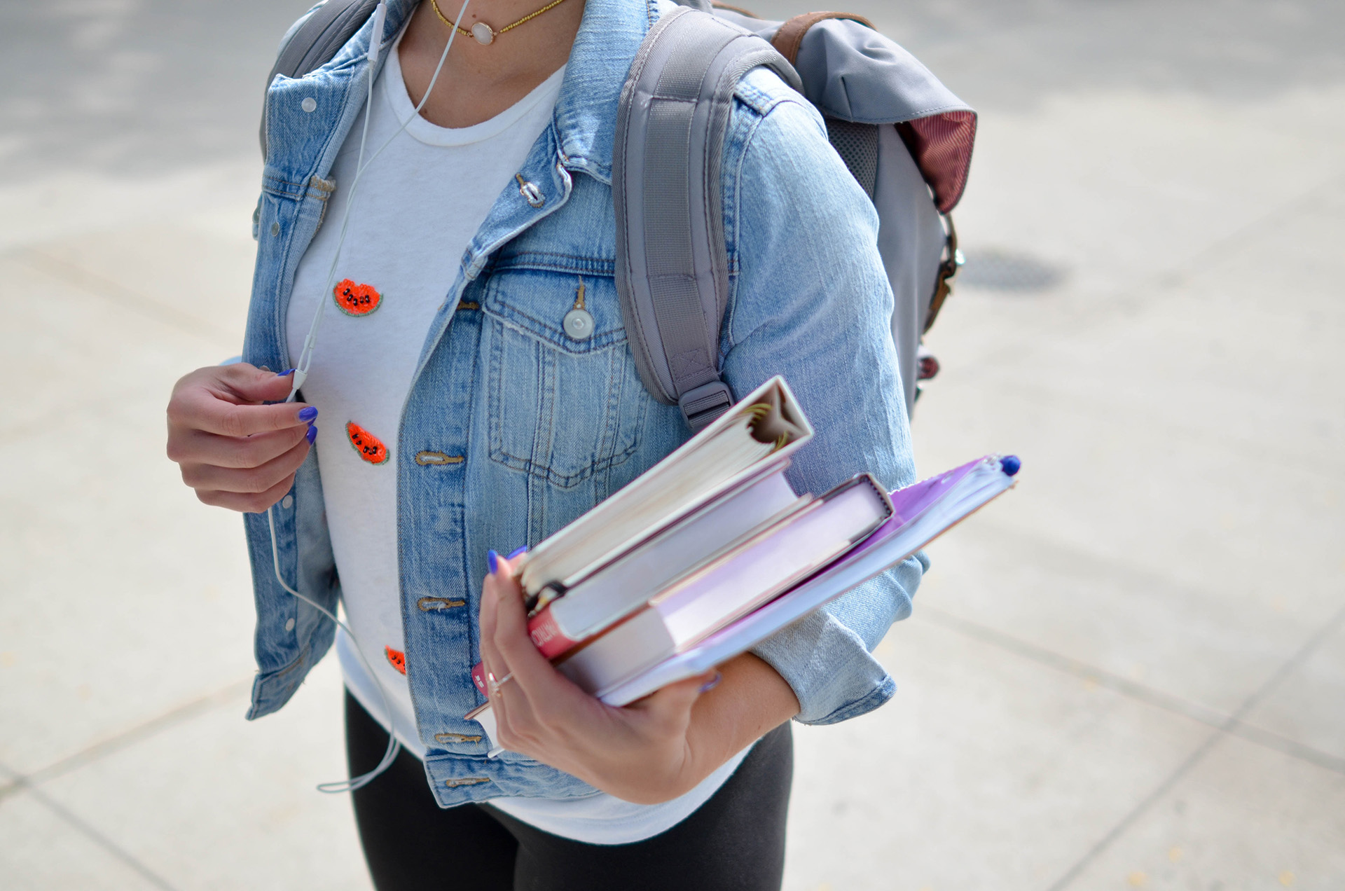 Student carrying text books and folders