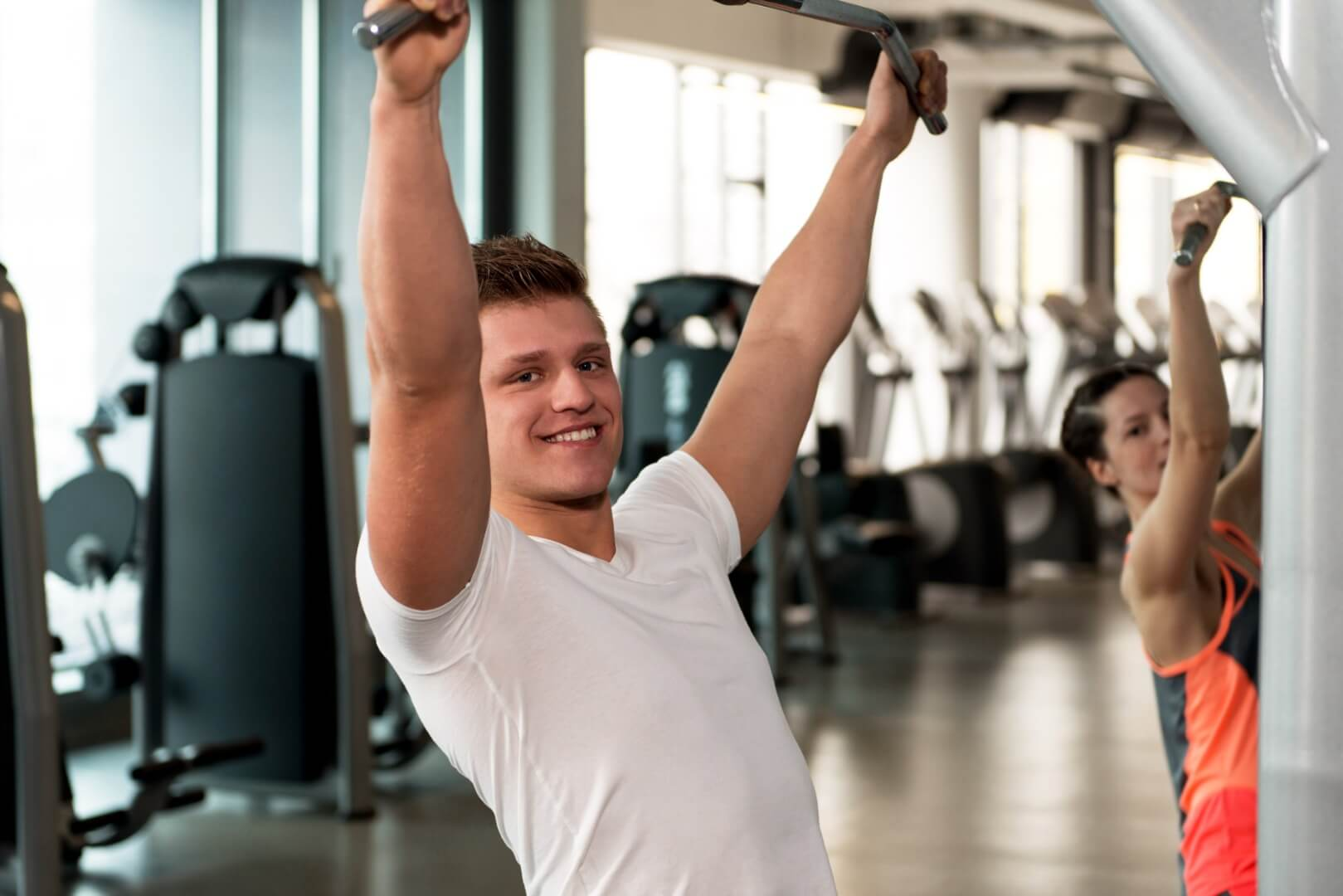 A young man works out in the gym