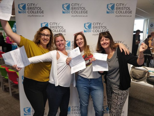 Four women celebrate their results