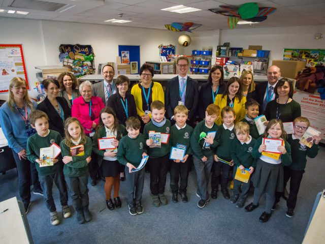 Students and teachers of Brunel Field Primary School, Bristol holding books