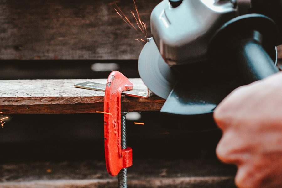 Angle grinder on clamped metal